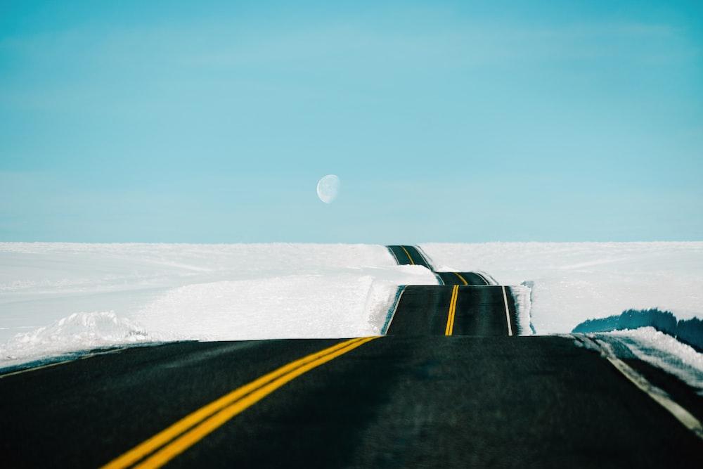 empty road under blue sky
