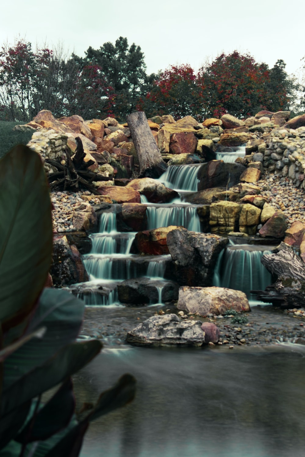 time-lapse photography of flowing multi-tier waterfall