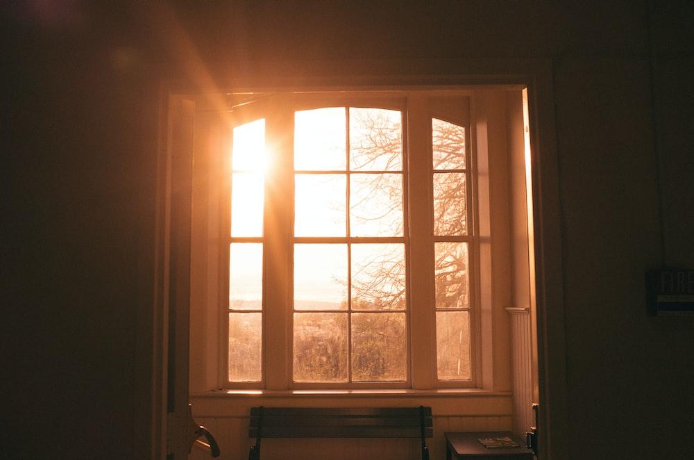 white wooden glass-panel window