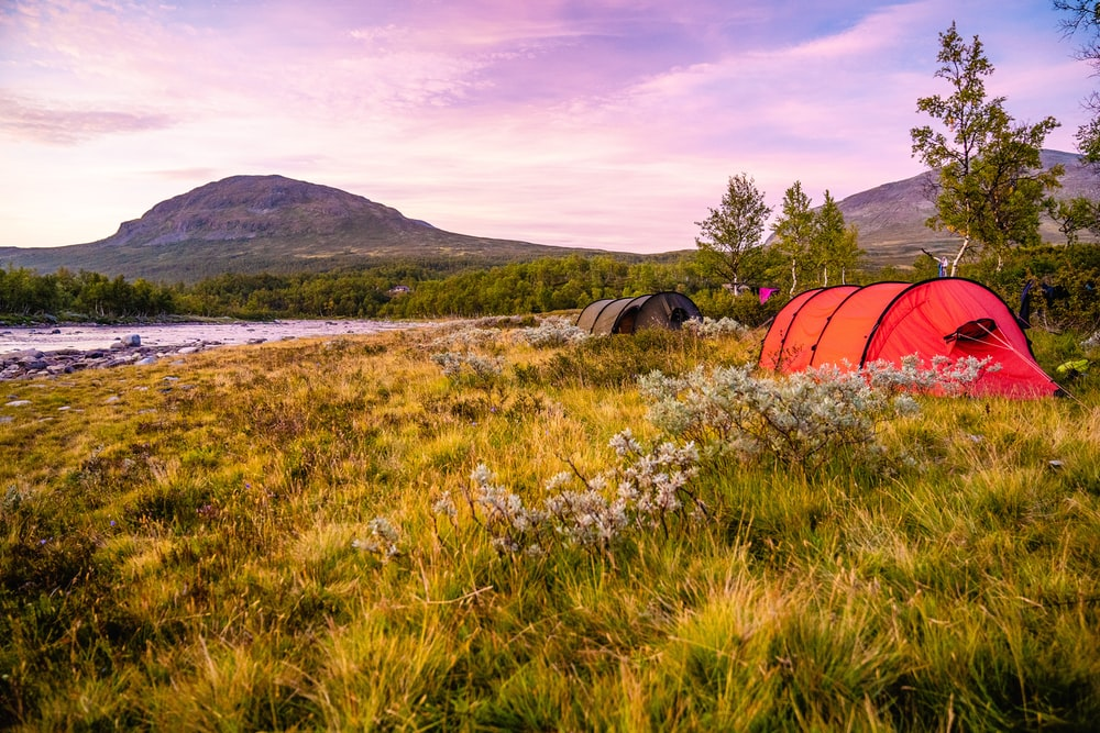 red and orange camping tent