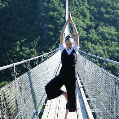 woman standing on bridge during daytime