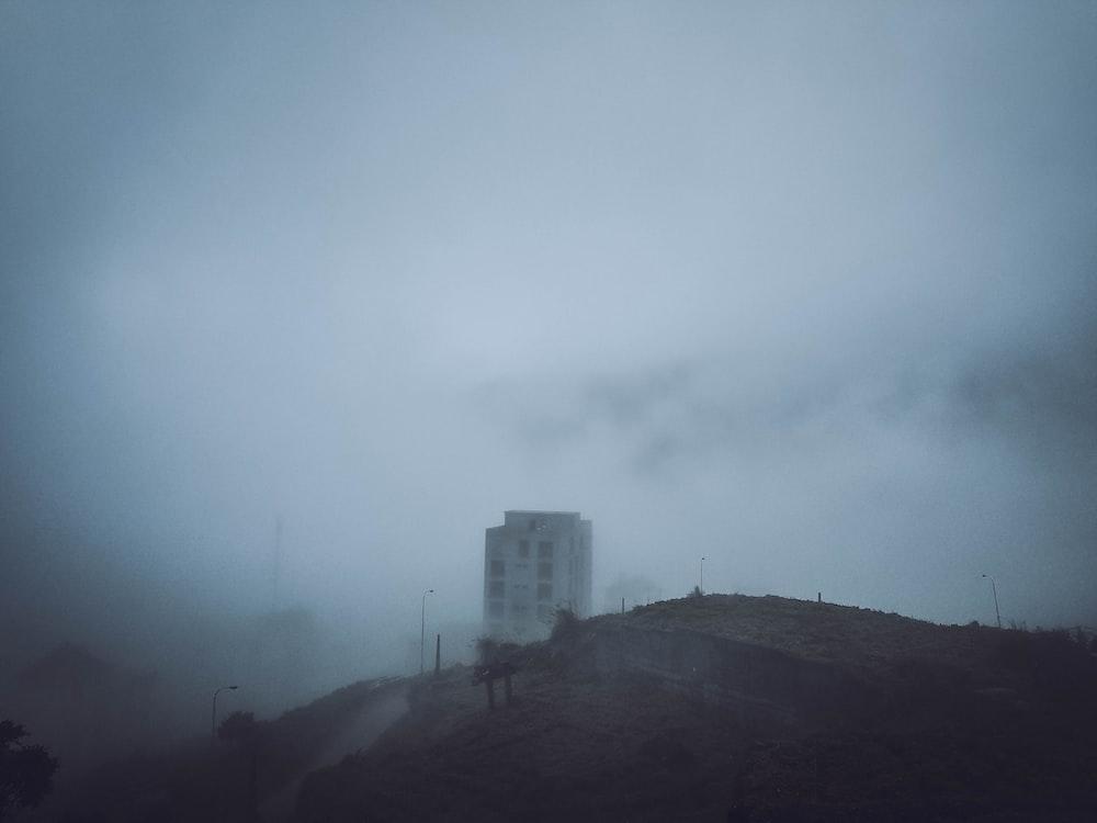 aerial photo of foggy concrete building