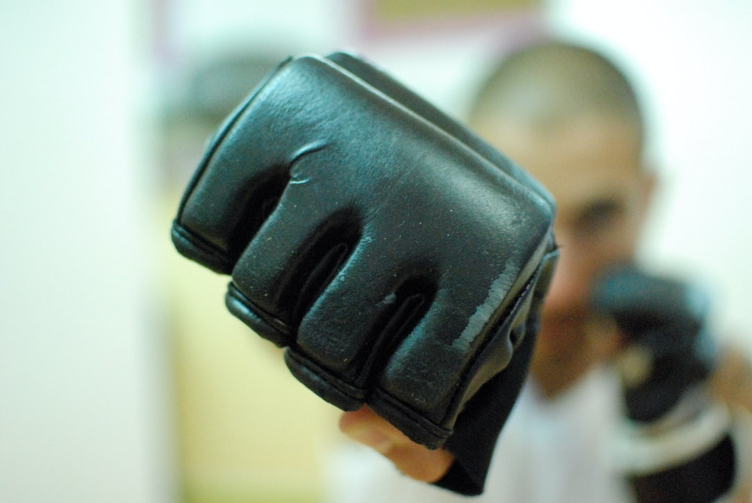 Close up man punch with fight glove - front view