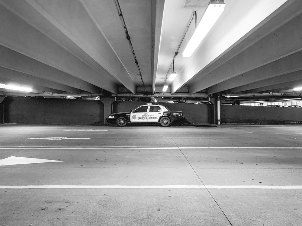 grayscale photography of police car on road