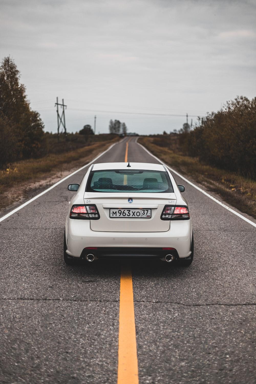 white car on roadway