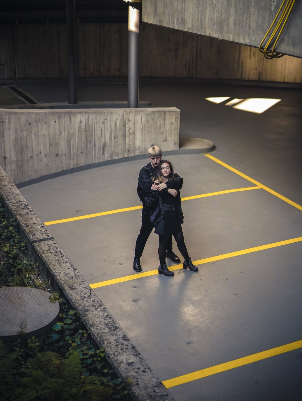 man and woman standing near concrete railings