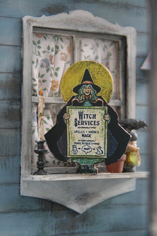 witch services signage on window shelf