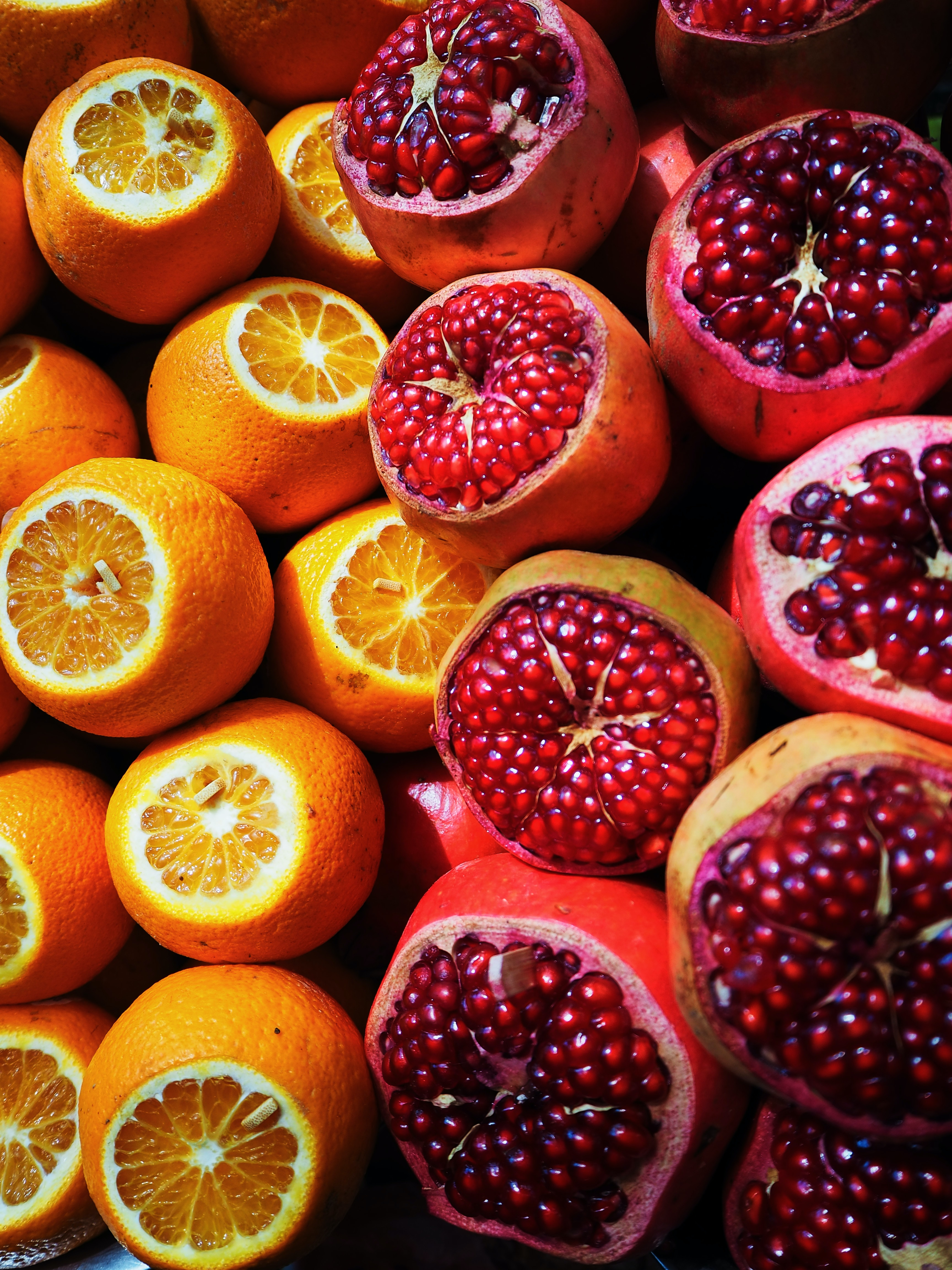 sliced orange and pomegranate fruits