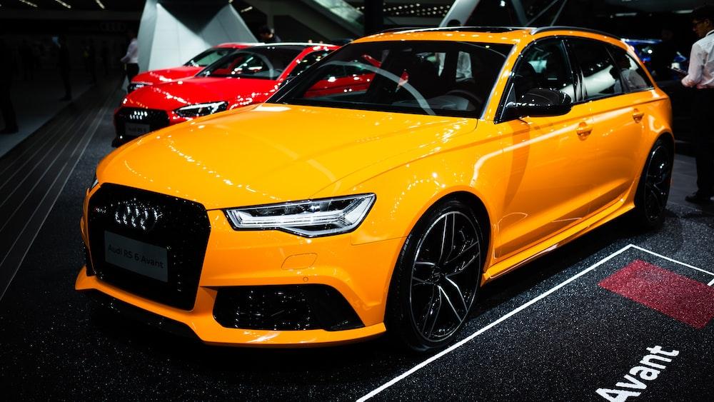 parked yellow Audi car