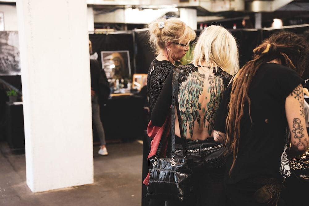 women in black tops