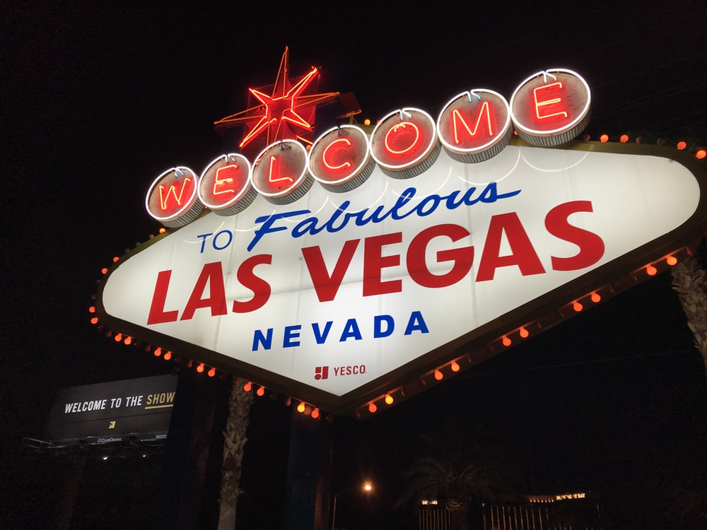 red and white lighted welcome to Las Vegas Nevada sign