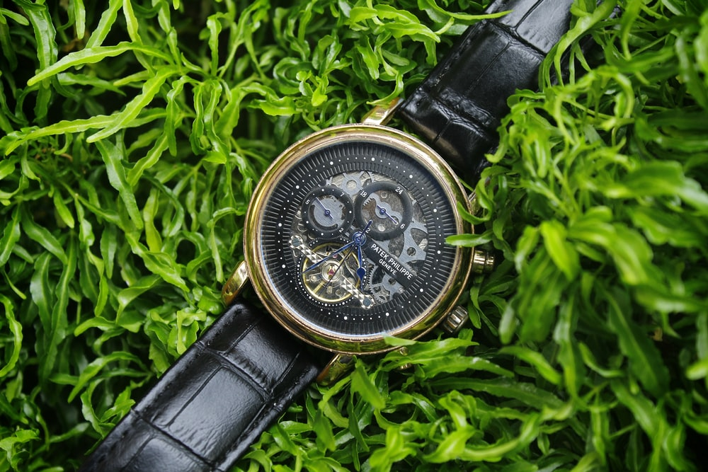 round silver-colored chronograph watch with black band