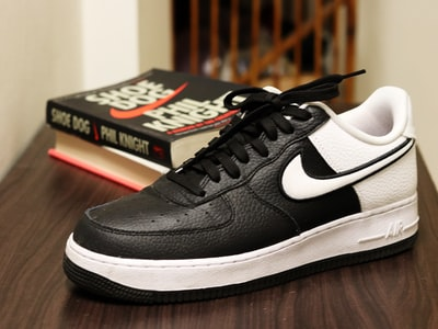 unpaired black and white nike low-top sneaker footwear zoom background
