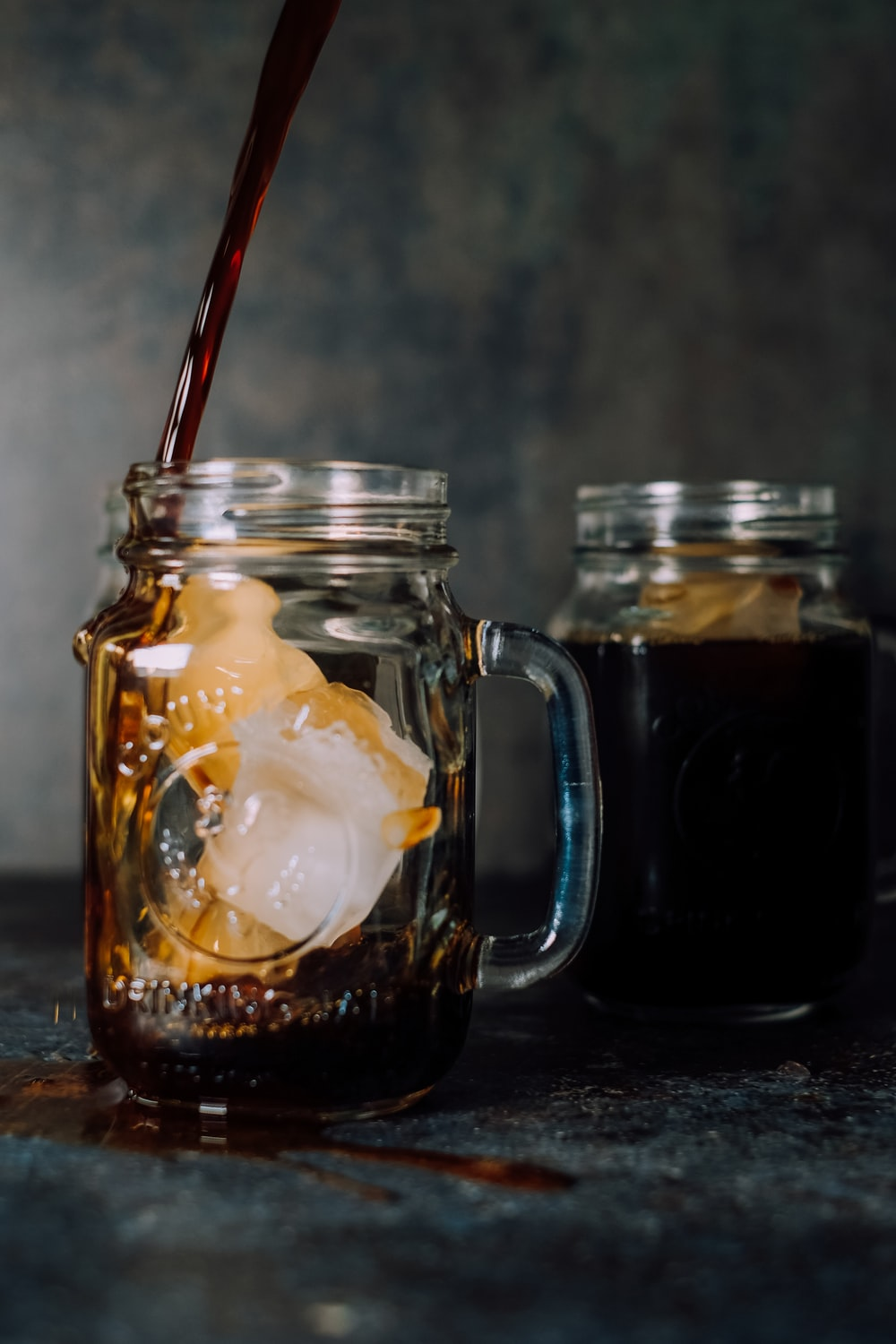 shallow focus photo of two clear glass mugs
