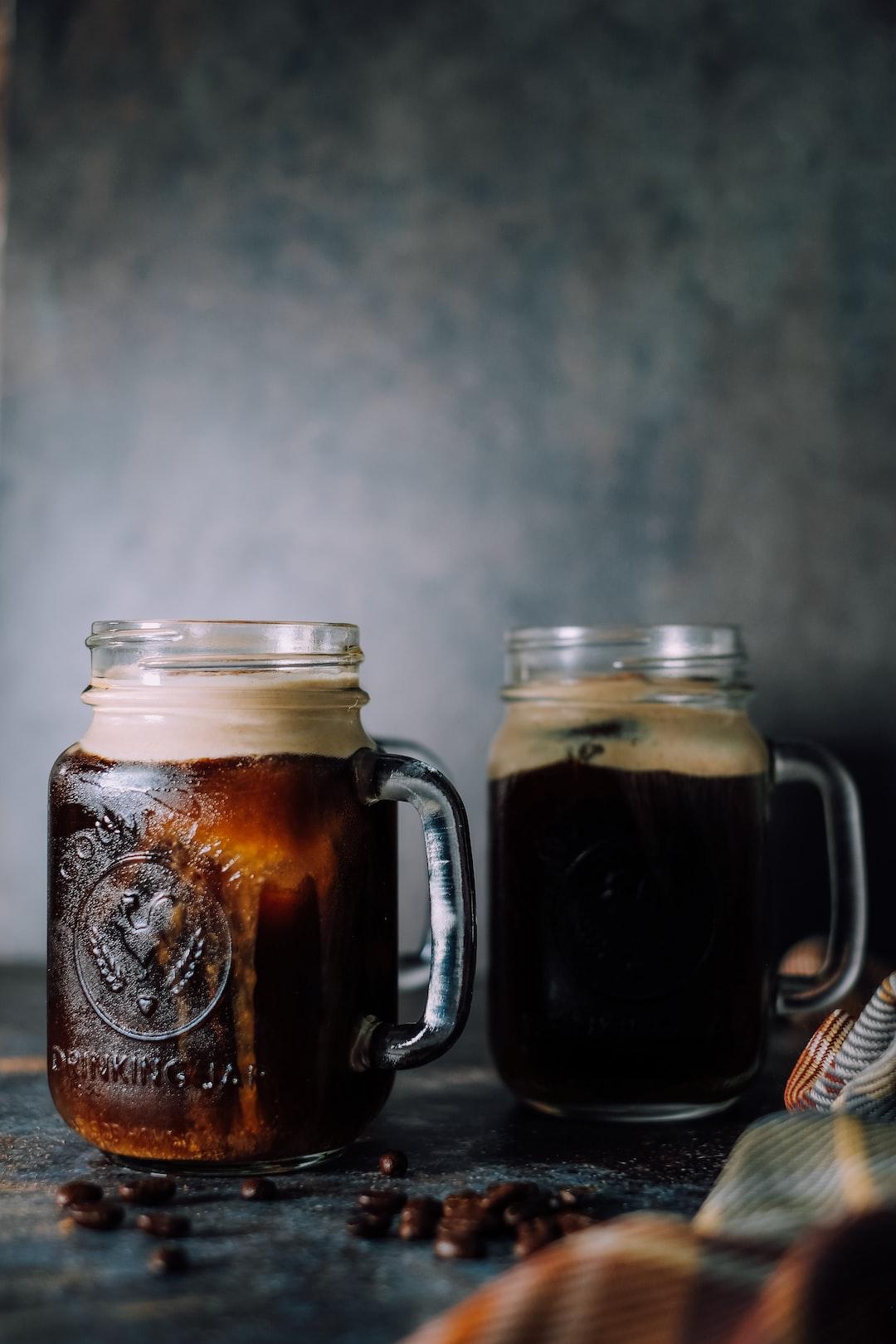 Pumpkin Cream Cold Brew Coffee into Glass Rustic Earthy Background