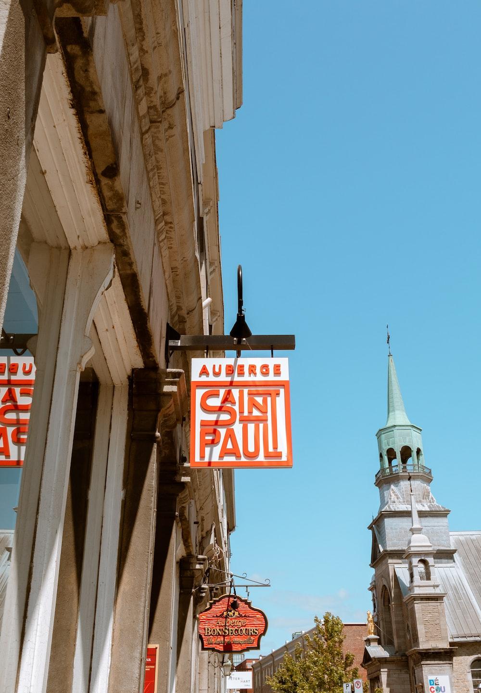 Aureros Saint Paul signage hanging outside a building