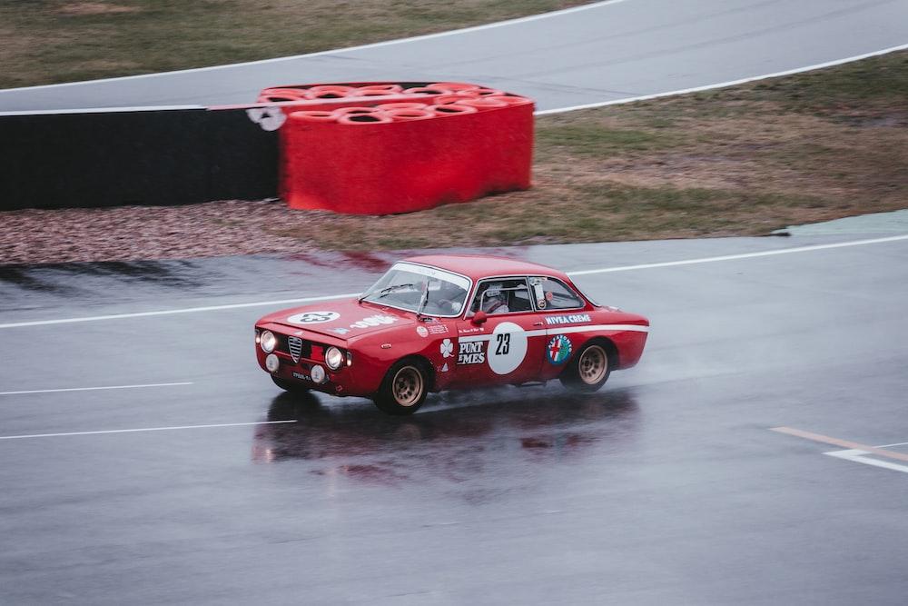red Alfa Romeo GTA on road during daytime