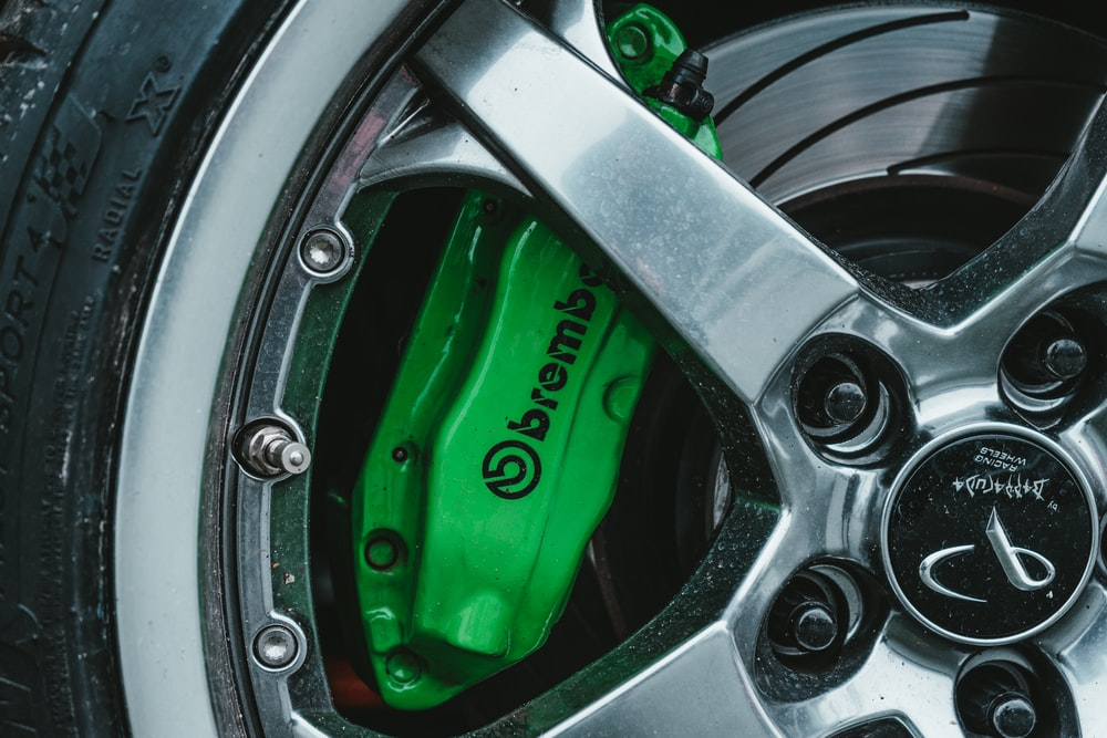 macro photography of chrome wheel and tire set