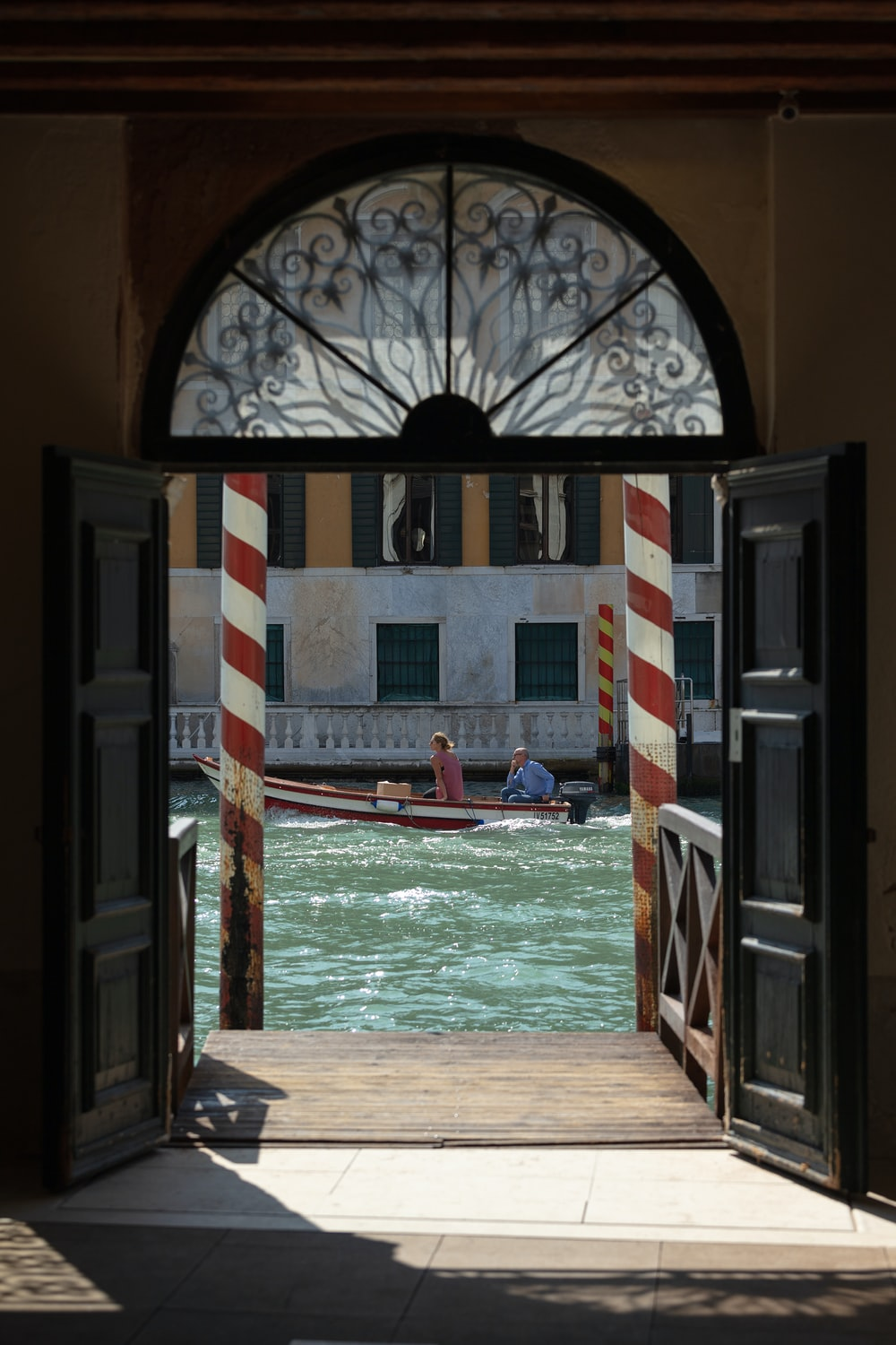 an open door leading to a canal