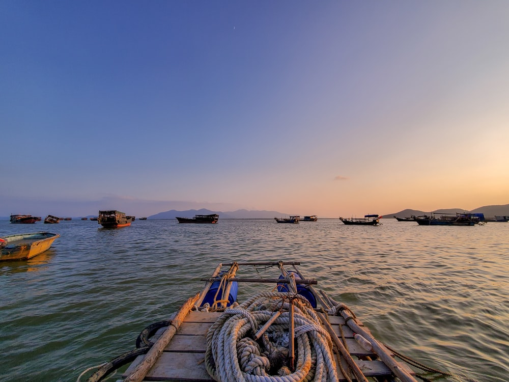 landscape photography of boats in the sea