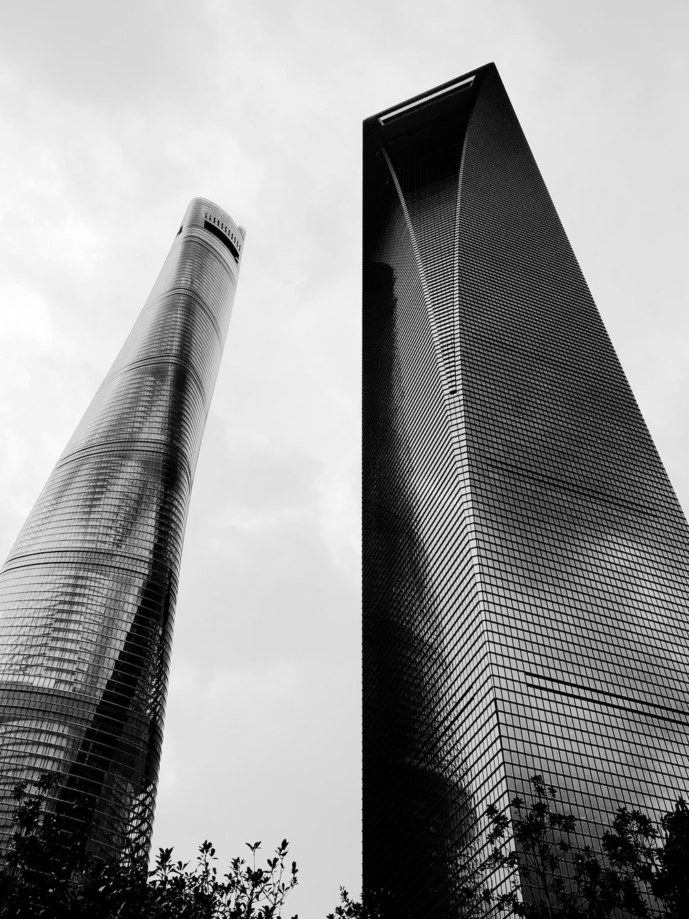 low-angle photography of two high-rise glass buildings