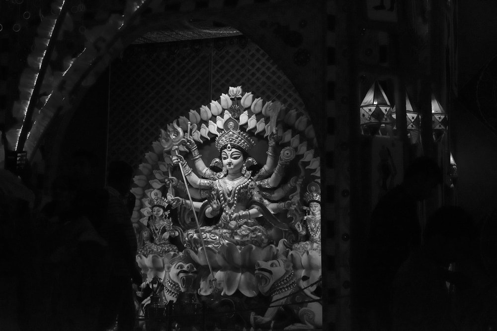 grayscale photography of Durga statue