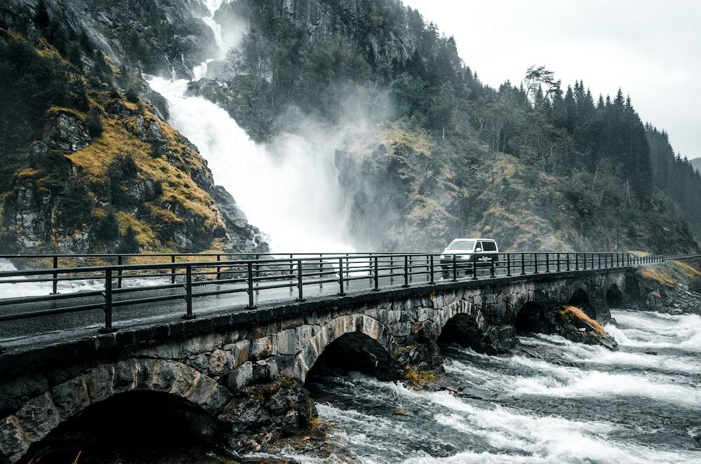 waterfalls running near bridge