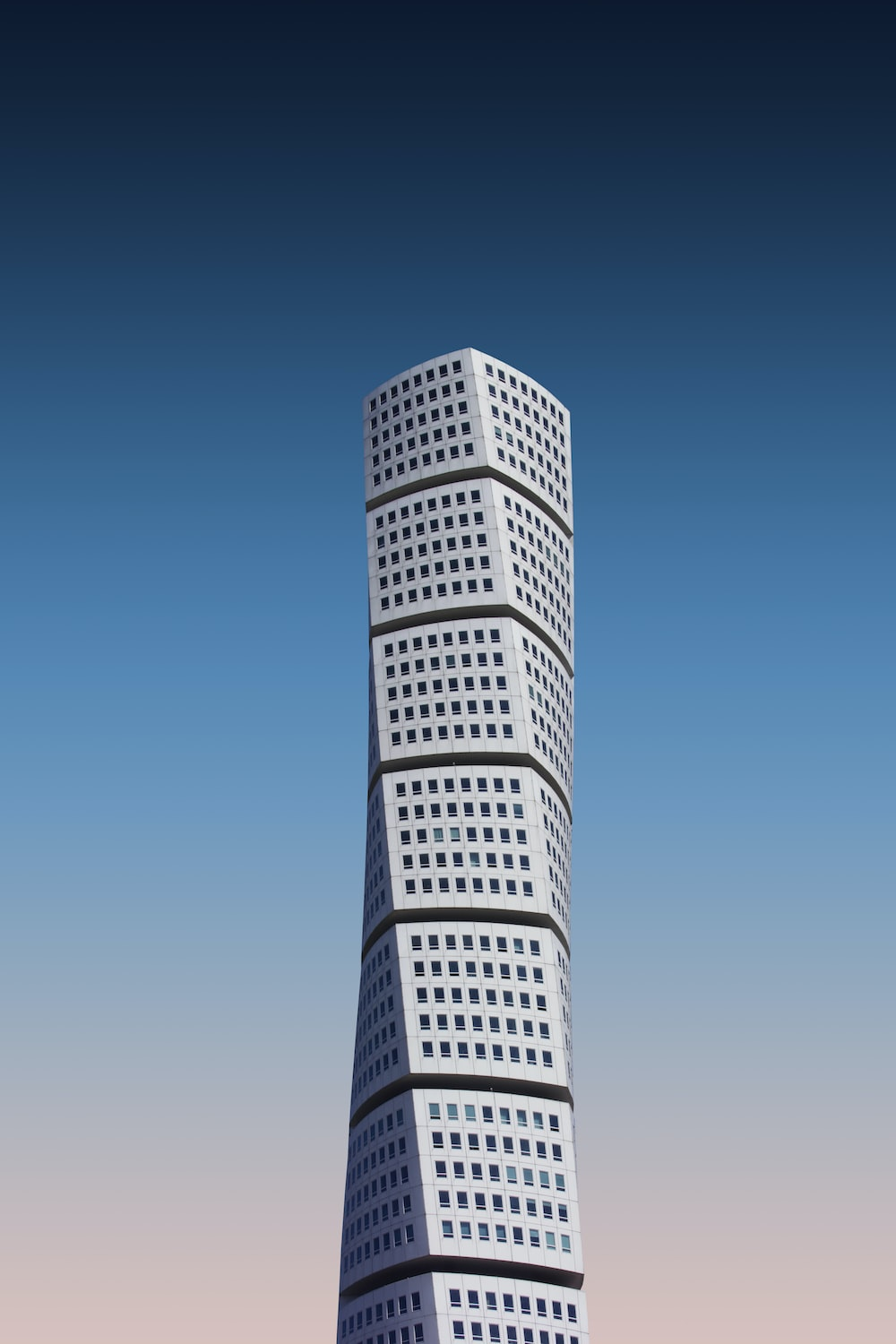 white high-rise building under a blue sky