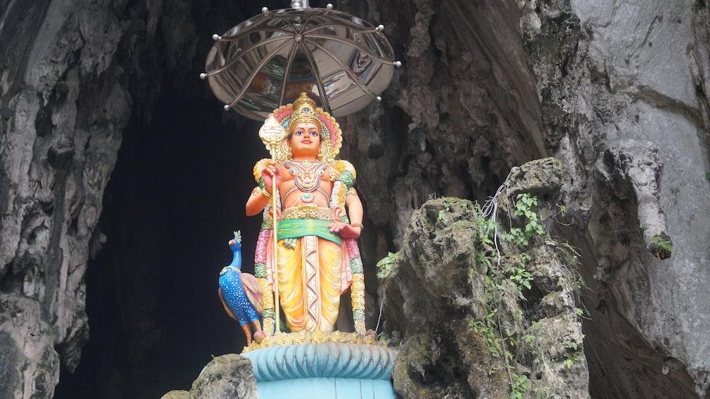 shallow focus photo of Hindu god statue
