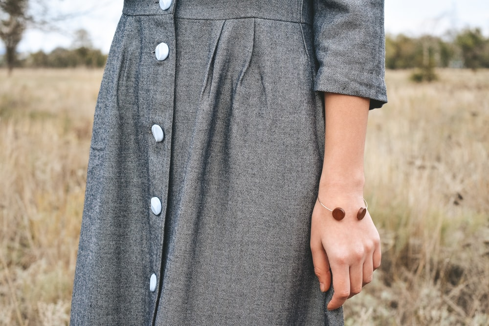 woman wearing black button-up long-sleeved dress