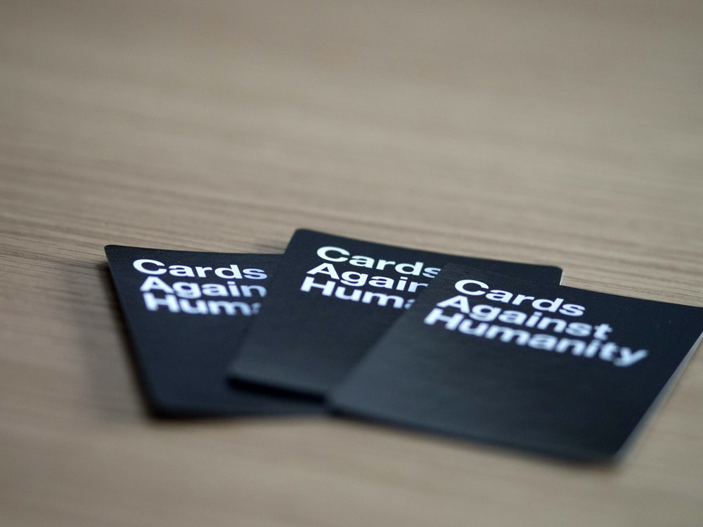 three Card Againsts Humanity cards
