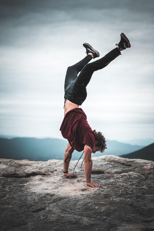 man doing stunt with maroon shirt