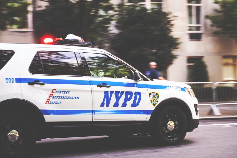 white and blue NYPD SUV