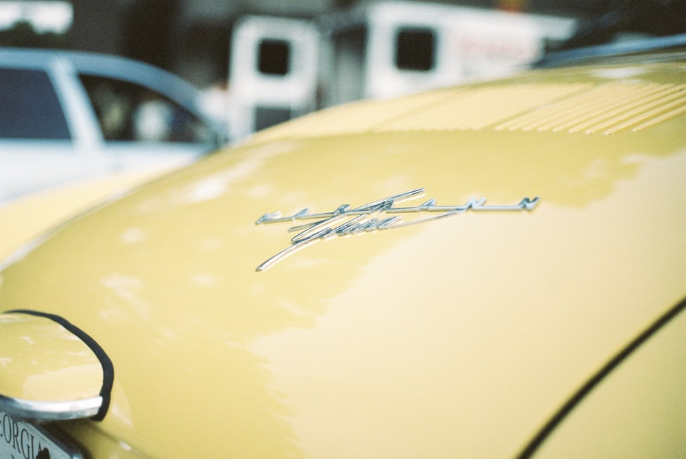 shallow focus photo of yellow car