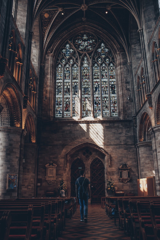 man walking inside church