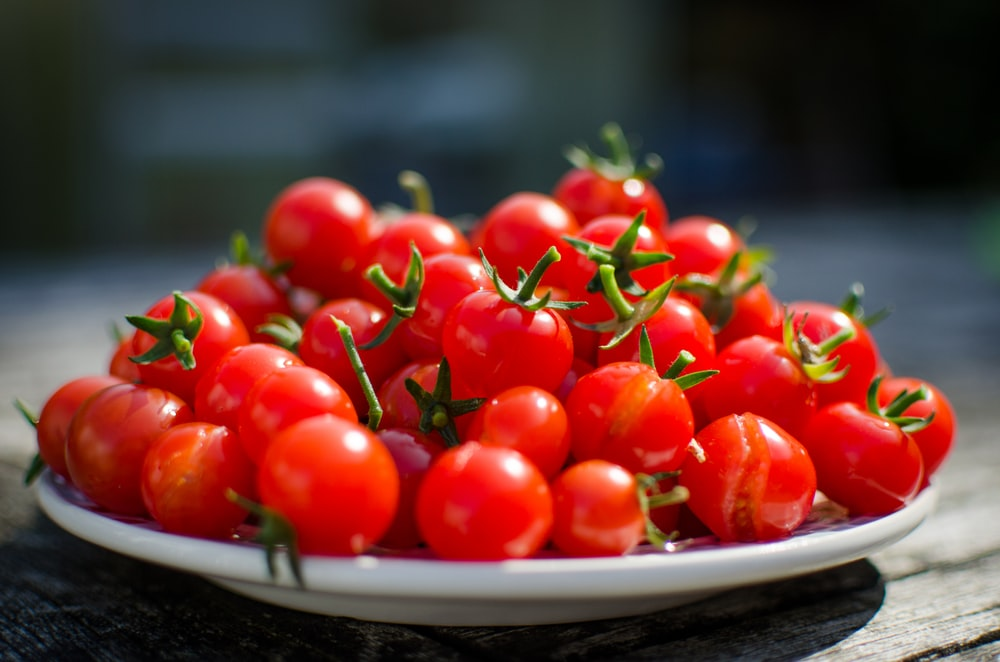 red cherry tomatoes on a plate