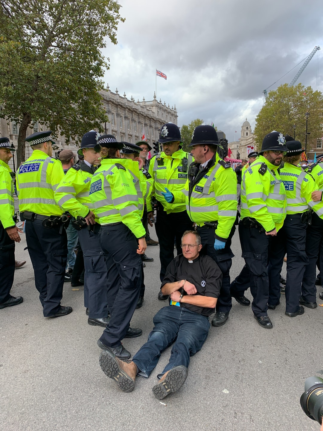 A vicar is about to be arrested for blocking Whitehall during the Extinction Rebellion protests, October 2019