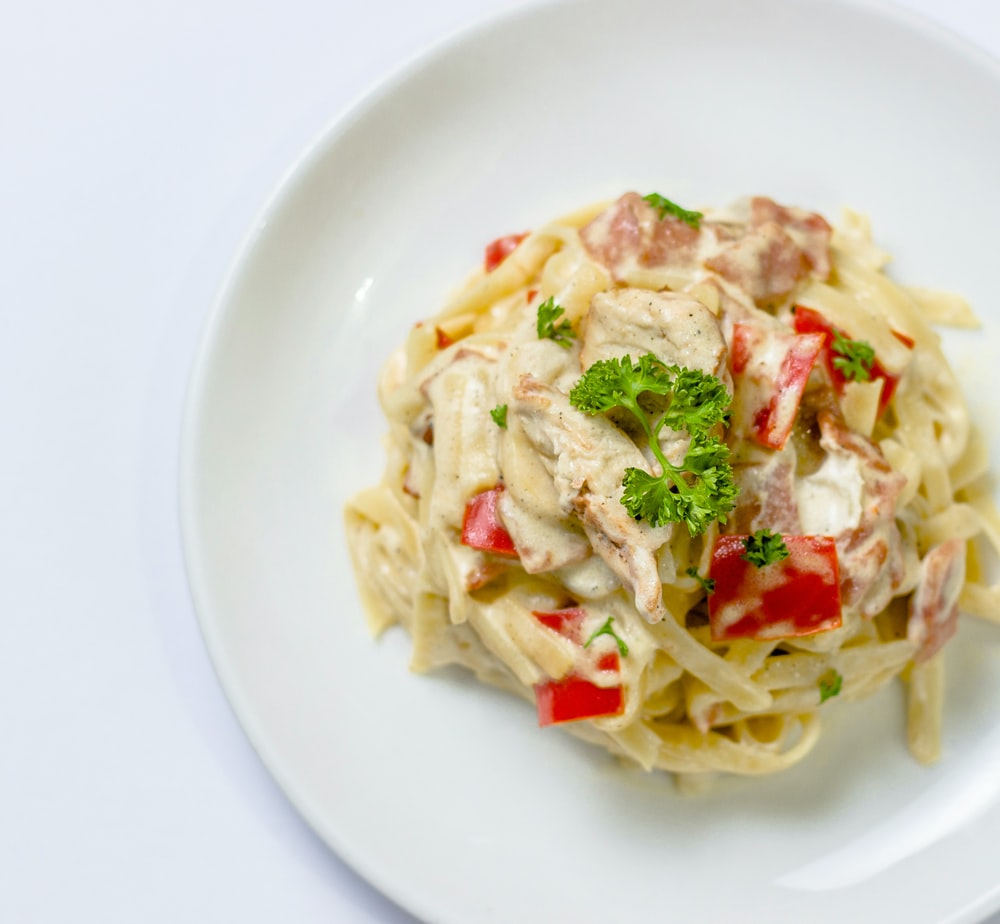 plate of white pasta with red bell pepper