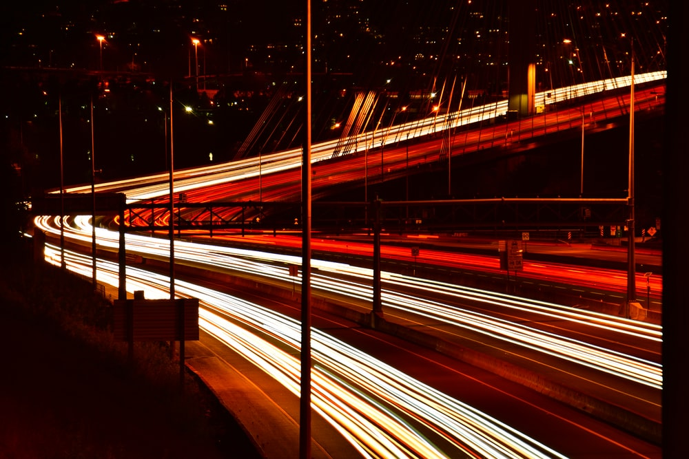 time-lapse photography of road during night time