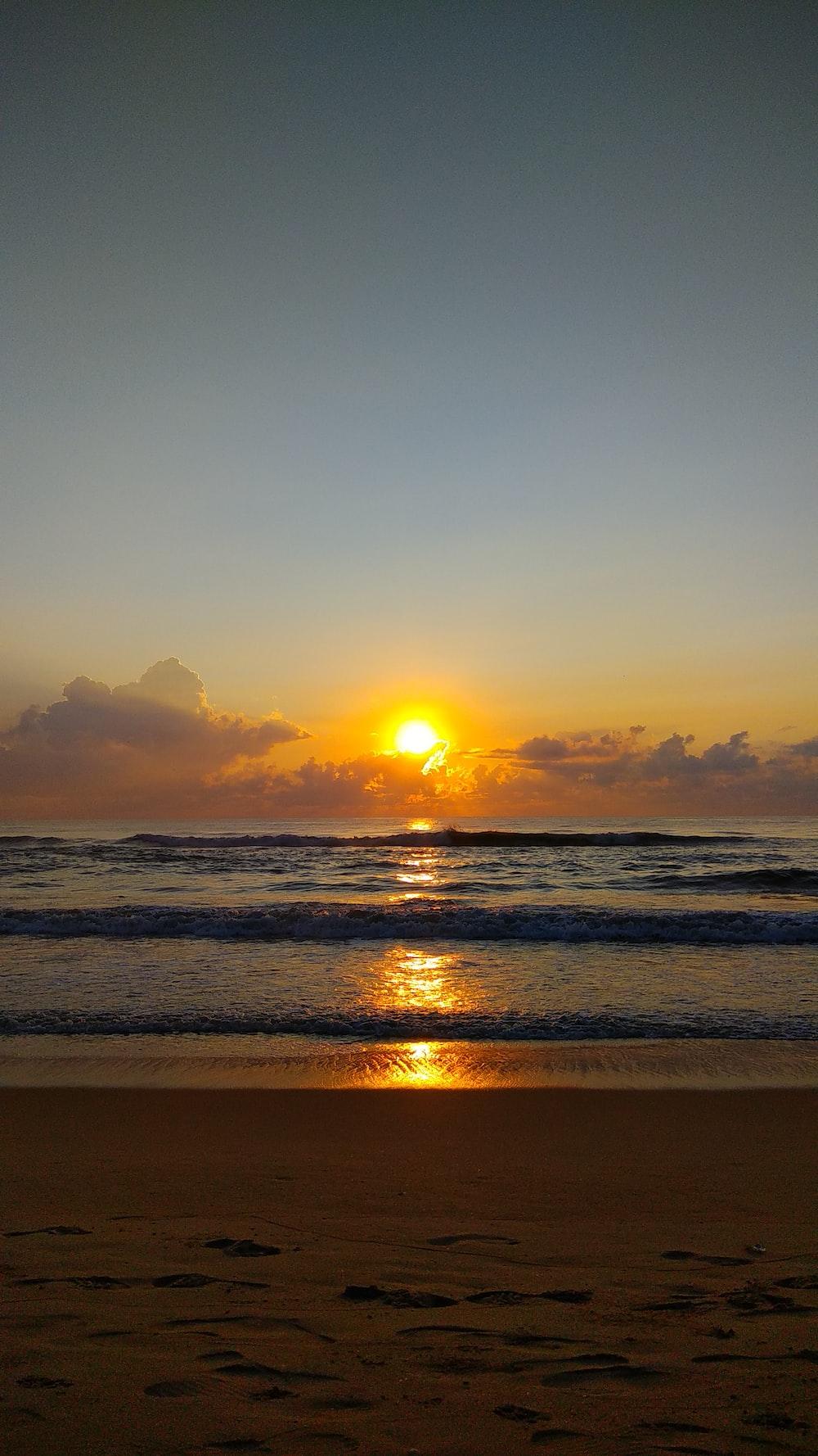 ocean wave during golden hour time