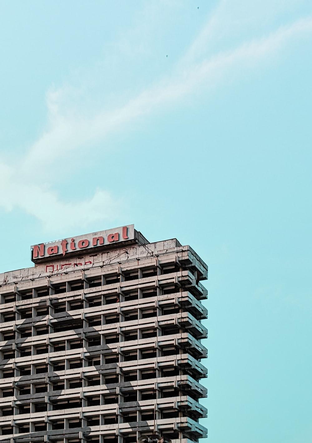 gray concrete multi-storey building under a calm blue sky