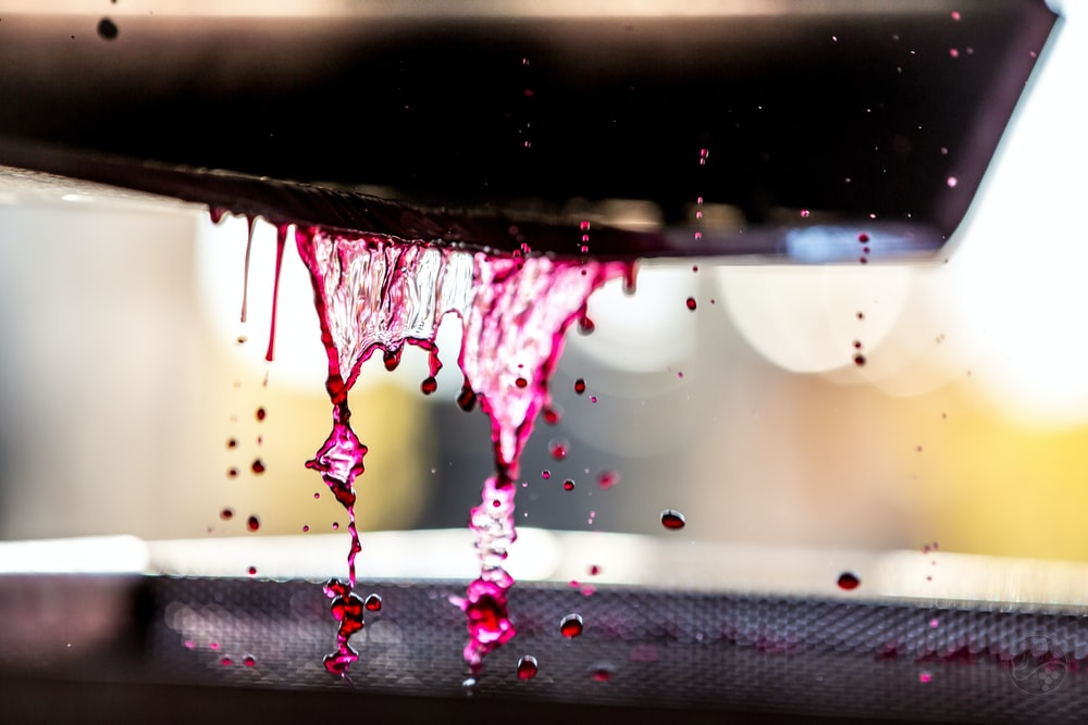 timelapse photography of dripping purple liquid