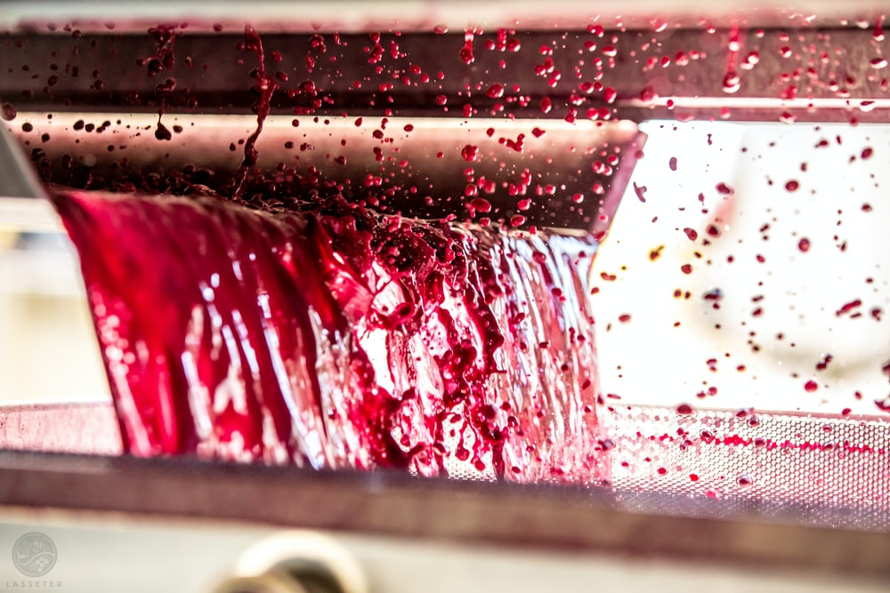 time-lapse photography of dripping red substance