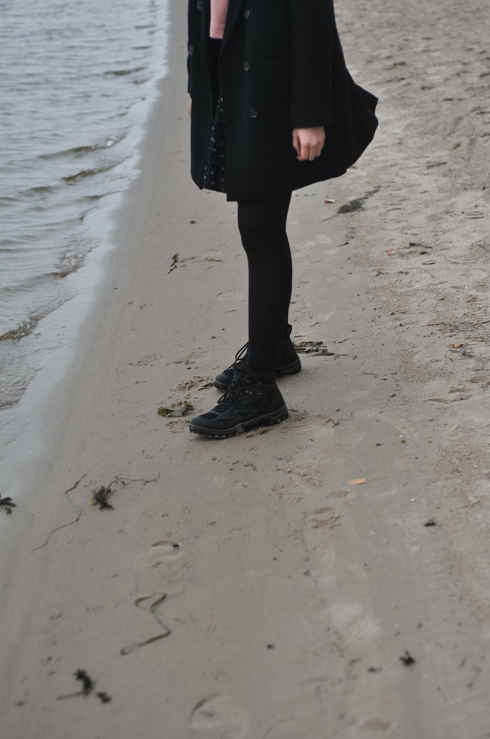 person stands near shore