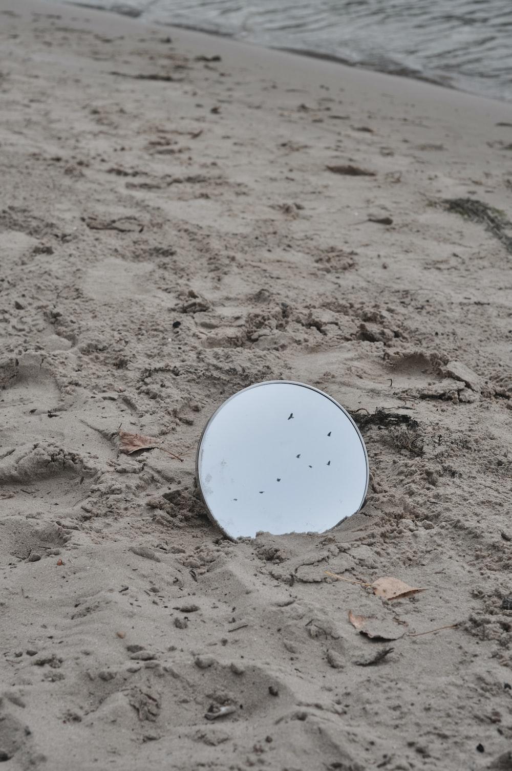 white round plastic on brown soil