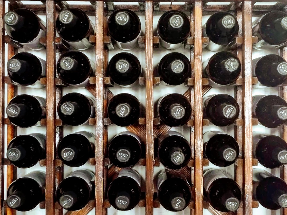 bottles on brown wooden crate