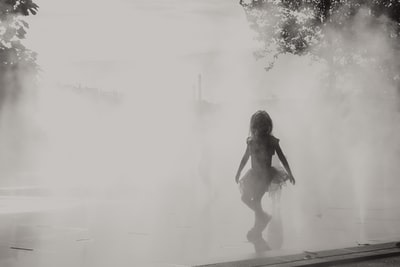 little girl dancing in the mist