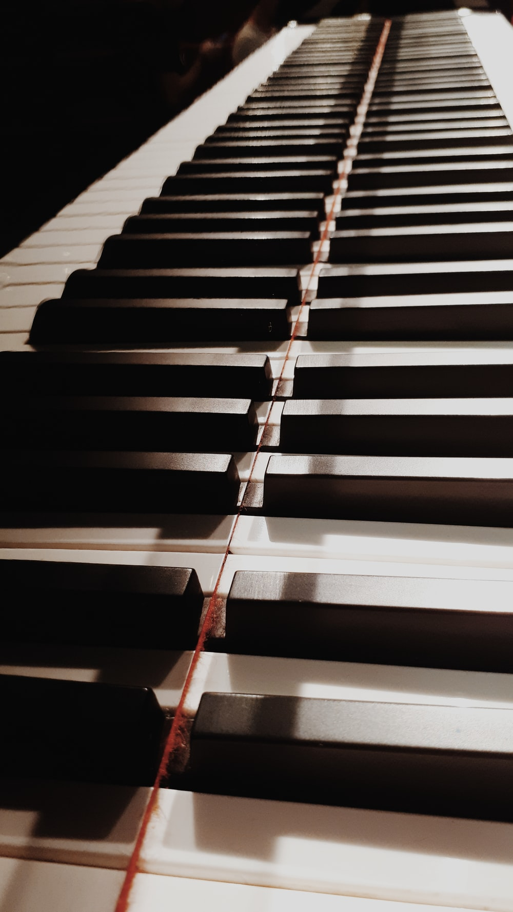 shallow focus photo of piano