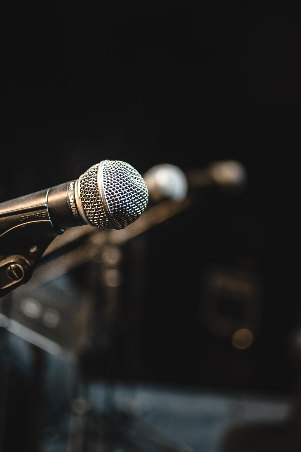 shallow focus photo of black microphone