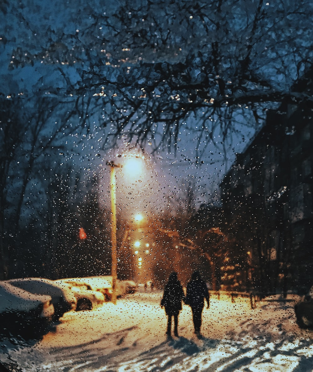 two women standing on snow